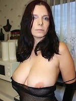 Extreme alternative lady with latex gloves and body net shows her awesome big hooters off